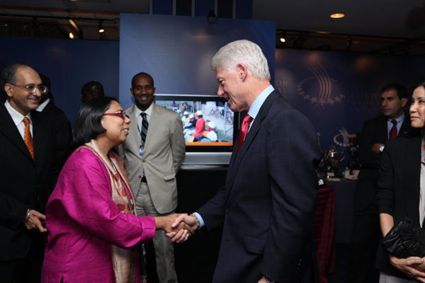 Ruchira and Bill Clinton